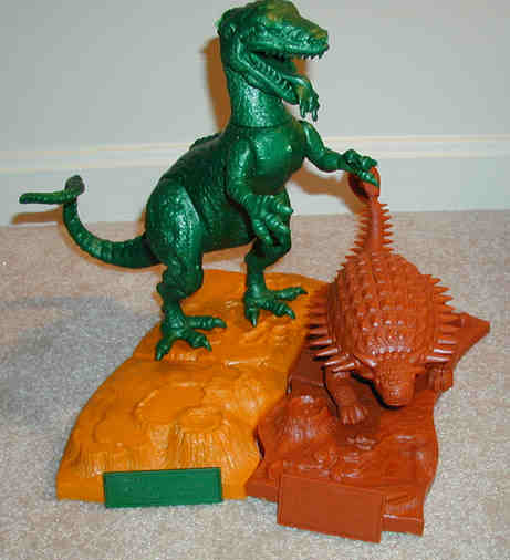 armored dino and allosaurus models